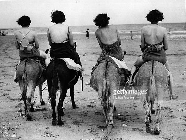 Women bathers riding donkeys on the beach at Ramsgate