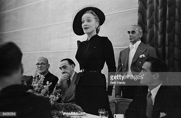 German screen actress Marlene Dietrich gives a press conference at the Savoy Hotel, whilst in London for the filming of 'Stage Fright'. Original...
