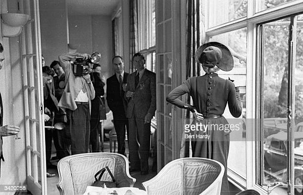 German screen star Marlene Dietrich grants an audience to some British journalists at the Savoy Hotel whilst in London for the filming of 'Stage...