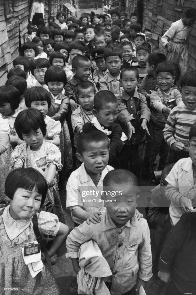 Korean War Orphans : News Photo
