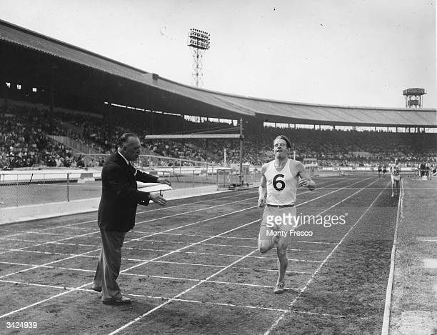 English athlete Chris Chataway as known as 'Red Fox' winning the 3mile event during the AAA Championships at White City London