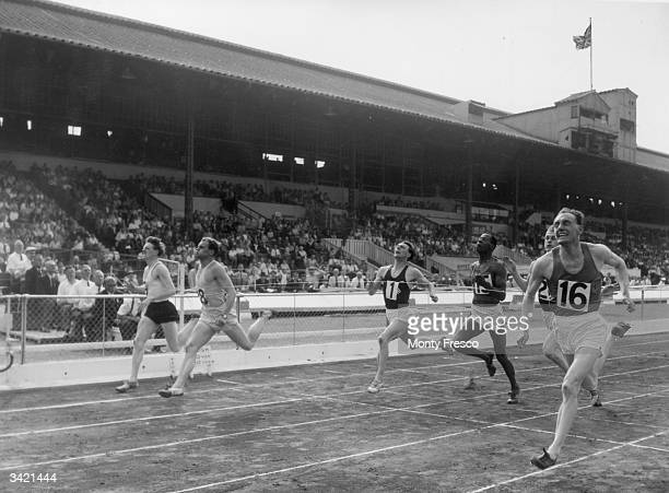 The finish of the 220 yard race at the AAA Championships at White City London G S Ellis comes in first followed by Sandstrom in second place and W...