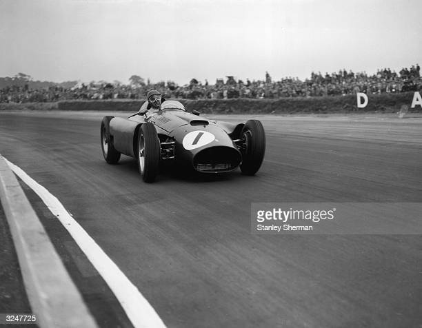 Argentinian racing driver Juan Manuel Fangio driving at Silverstone.