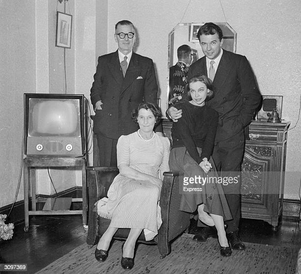 French film star Leslie Caron with her fiance the theatre and film director Peter Hall and his parents