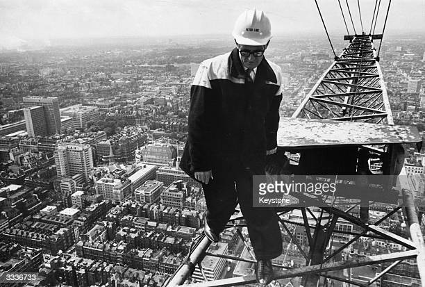 Crane operator Jimmy Wheelan balances 635 feet above the city of London at the top of the Post Office Tower for the ceremony marking the completion...