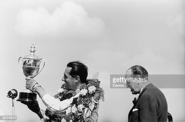 Jack Brabham with the International Daily Express Trophy after winning the British Grand Prix at Silverstone