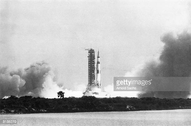 The Apollo 11 Saturn V rocket lifts off its pad at Kennedy Space Centre in Florida carrying astronauts Neil Armstrong Buzz Aldrin and Michael Collins...