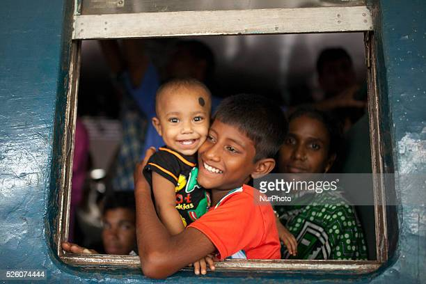 A family sit inside the train as they head to their homes to celebrate Eid alFitr in Dhaka on 16th July 2015 Hundreds of thousands of people working...