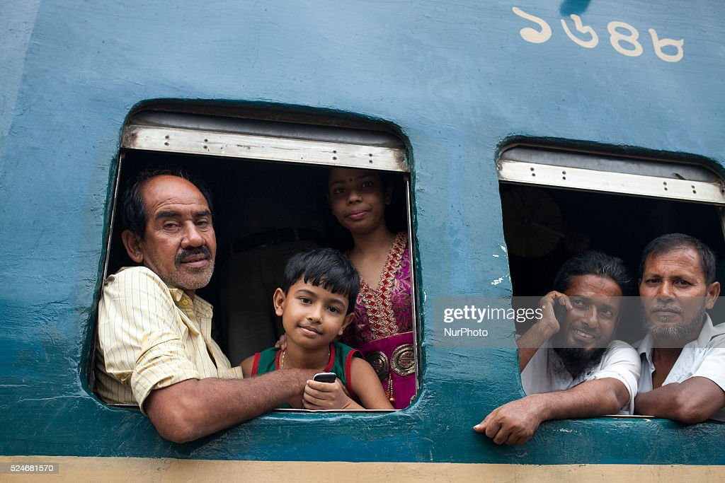 Bangladeshi passengers sit on the roof of a train, as they head to their homes to celebrate Eid al-Fitr in Dhaka on 16th July 2015. Hundreds of thousands of people working in Dhaka plan to leave for their home towns to celebrate with their family the upcoming Eid al-Fitr.