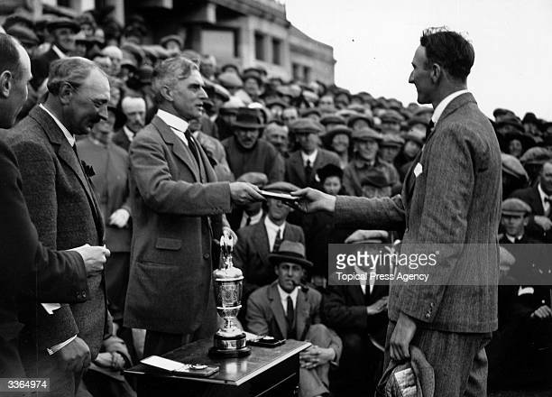 British golfer Arthur Havers receiving his winner's medal from Sir Alec Walker at the British Open held at Troon in Ayrshire The 8th hole at Royal...