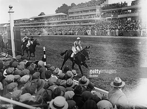 Mr Joel's Polyphontes winning the Derby on the second day at Epsom