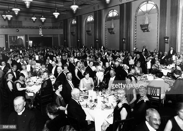 Guests at the anniversary dinner of the EnglishSpeaking Union at the Cafe Royal London They are listening to a speech by jurist and statesman Rufus...