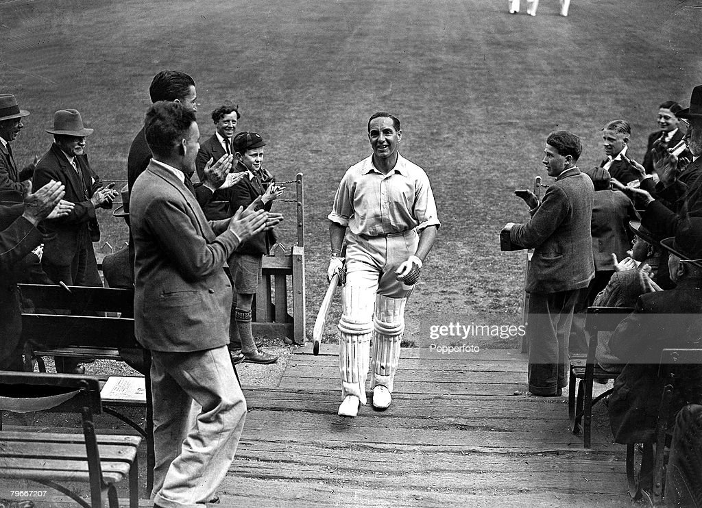 16th June 1932, Percy Holmes and Herbert Sutcliffe broke world record cricket partnership with a score of 555 for their Yorkshire team in a match versus Essex at Leyton, London, Herbert Sutcliffe returns to the pavilion after the record innings : News Photo