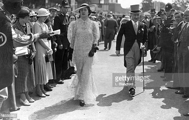 Couple at the Ascot races show off their splendid high society fashions.