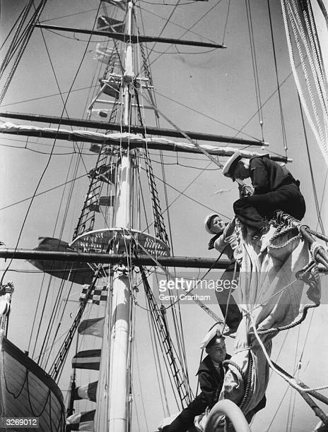 Naval cadets on board the China tea clipper 'Cutty Sark' built in 1869 overhauling the rigging before the ship sets sail from Falmouth to London She...