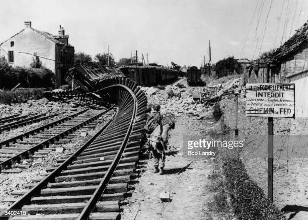 Blasted and twisted railway tracks at Carentan after the town was taken by African Troops