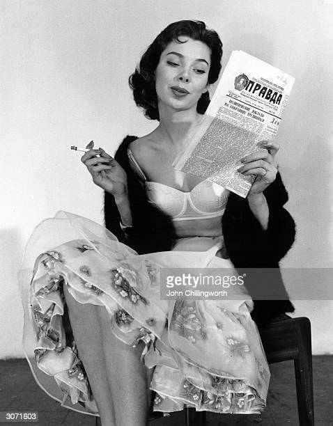 A Russian girl reads Pravda as she models British underwear in a sales campaign Original Publication Picture Post 8420 Some Pretty Things For Moscow...