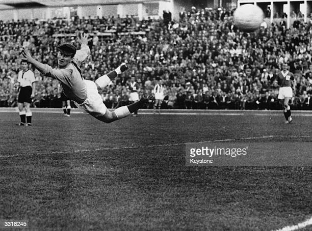 Harry Gregg Northern Ireland's goalkeeper fails to stop West Germany's Uwe Seeler scoring the equalising goal during their World Cup match at Malmo...