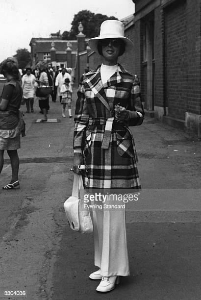 Miss Daphne Barry modelling her trouser suit and jacket at Ascot