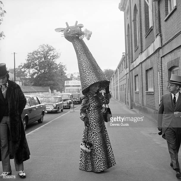 Gertrude Shilling mother of hat designer and milliner David Shilling with one of her son's characteristically flamboyant hats which she wears...