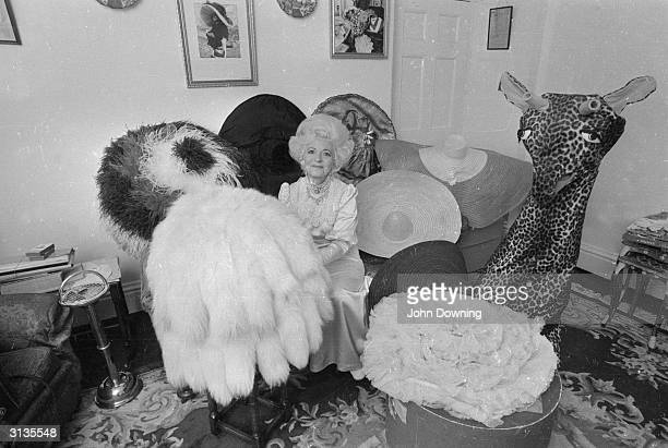 Gertrude Shilling, mother of hat designer and milliner David Shilling, with one of her son's characteristically flamboyant hats which she wears...