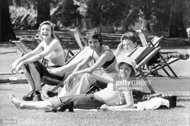 Office girls strip down to their underwear to sunbathe in St Jame's Park the bra substituting for a bikini top