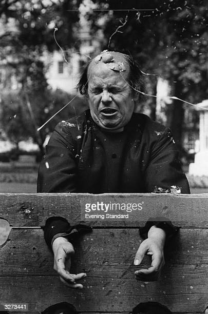 The Reverend John Pellow being struck by an egg whilst in the stocks at the Midsummers Fair in St James' Park London