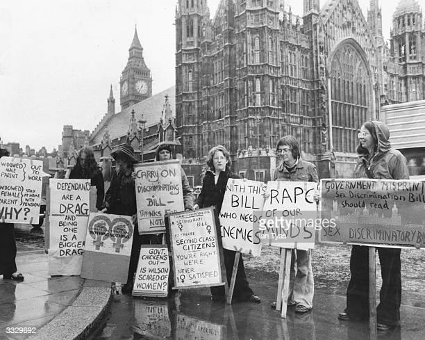 Women representing the Women's Liberation Movement protesting against the Government's Sex Discrimination Bill outside the House of Commons London