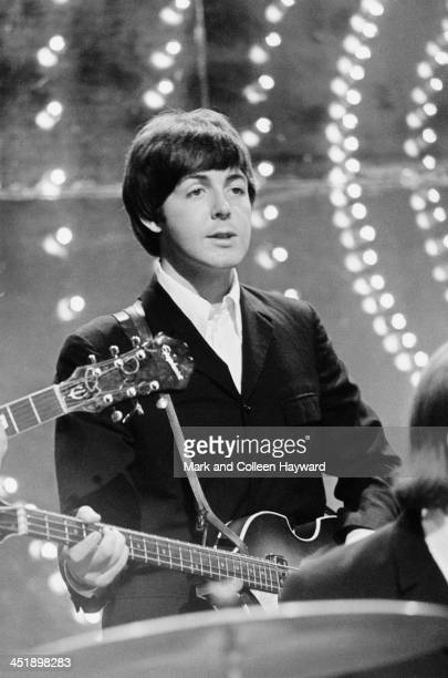 Paul McCartney from The Beatles performs 'Rain' and 'Paperback Writer' on BBC TV show 'Top Of The Pops' in London on 16th June 1966