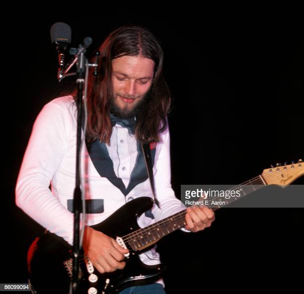 Photo of PINK FLOYD and David GILMOUR David Gilmour performing live onstage playing black Fender Stratocaster guitar on Wish You Were Here tour at...