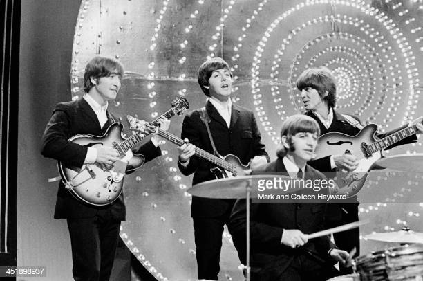 The Beatles perform 'Rain' and 'Paperback Writer' on BBC TV show 'Top Of The Pops' in London on 16th June 1966. Left to right: John Lennon , Paul...