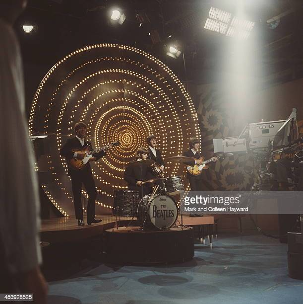 The Beatles perform 'Rain' and 'Paperback Writer' on BBC TV show 'Top Of The Pops' in London on 16th June 1966. Left to right; John Lennon , Ringo...