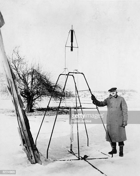 American physicist Dr Robert Hutchings Goddard standing next to the first liquidpropelled rocket prior to its launch at Auburn Massachusetts