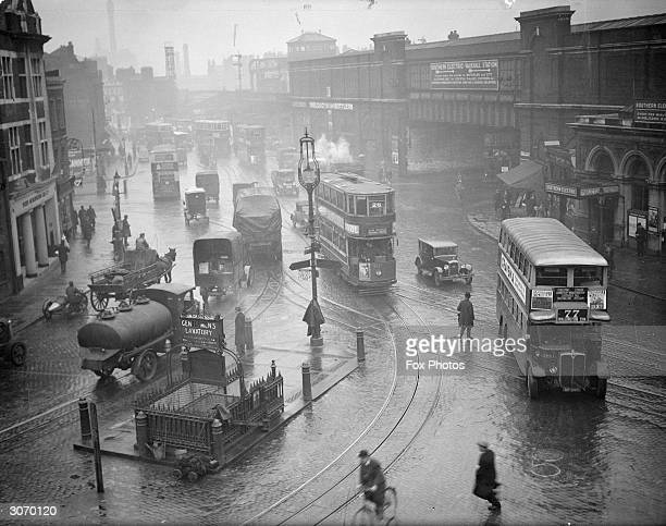 A tramcar and bus in the traffic at Vauxhall south London