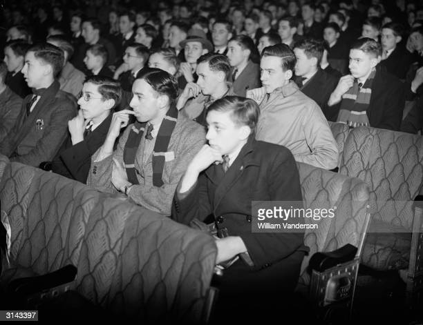 Schoolboys from several schools including Westminster School watching the H G Wells film 'Things To Come' at the Leicester Square Theatre