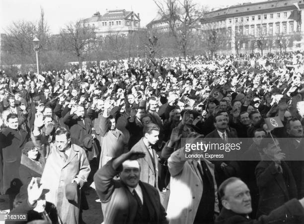 Austrians demonstrating their approval of the 'Anschluss' of Austria into the German Reich by giving the Nazi salute at a rally in Vienna.