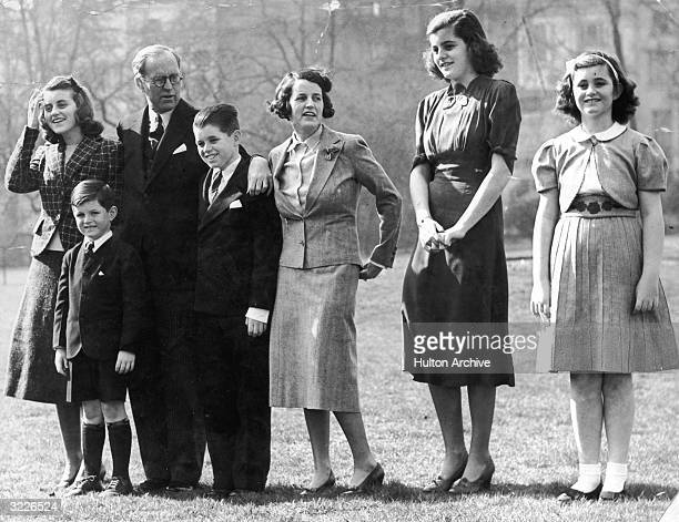 Full-length image of Joseph P Kennedy with his daughter Kathleen, sons Teddy and Robert, wife Rose, and daughters Patricia and Jean, London, England.