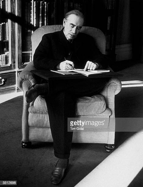 English economist John Maynard Keynes , 1st Baron Keynes of Tilton, at work in his London office. Original Publication: Picture Post - 361 - Mr....