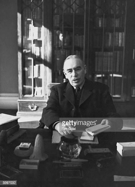 John Maynard Keynes , the British economist, whose theories profoundly influenced much government economic policy, at work in his study in...