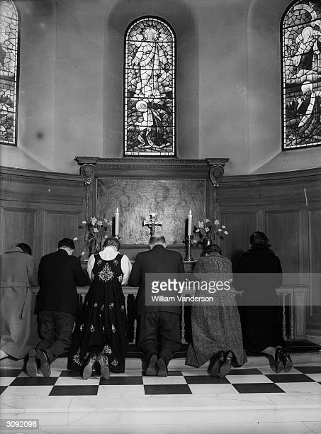 Norwegians praying in the Norwegian church, Rotherhithe after the news of the invasion of their country by the Germans.