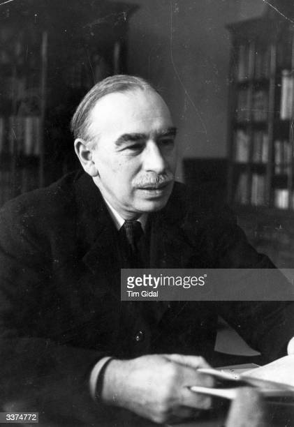 English economist John Maynard Keynes, 1st Baron in his study. Original Publication: Picture Post - 361- Mr Keynes Has A Plan - pub. 1940