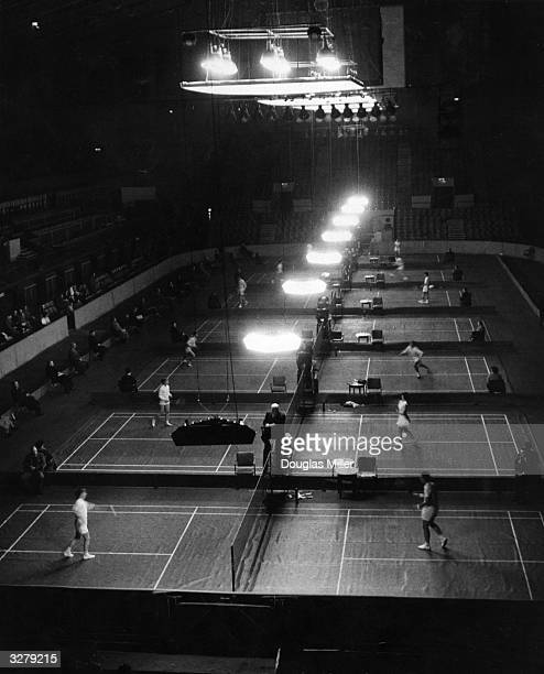 The start of the All-England Badminton Championships, being held at Wembley.