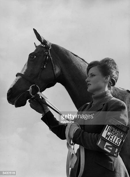 The wife of jockey Paul Kellawaywith the racehorse 'Tunbridge Wells' which is owned by seven hundred residents of the town of Tunbridge Wells