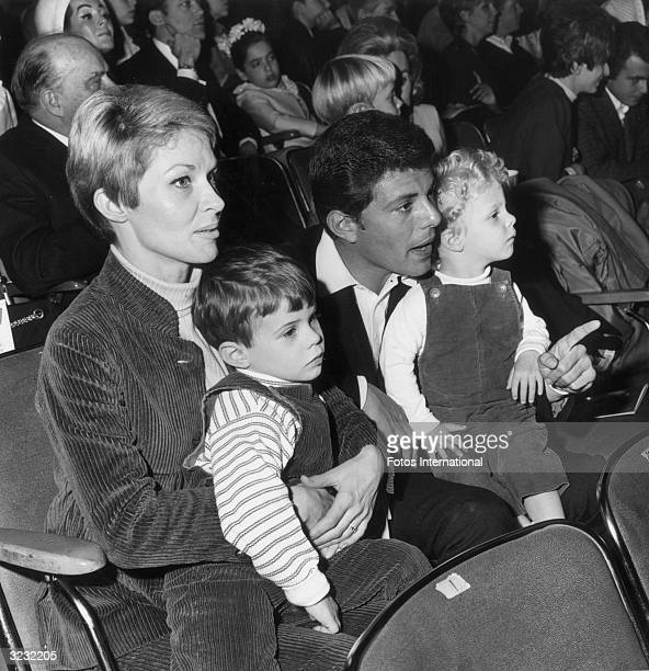 American actor and singer Frankie Avalon sits in the audience with his wife, Kay, and their two sons, as they attend the Dobritch International...