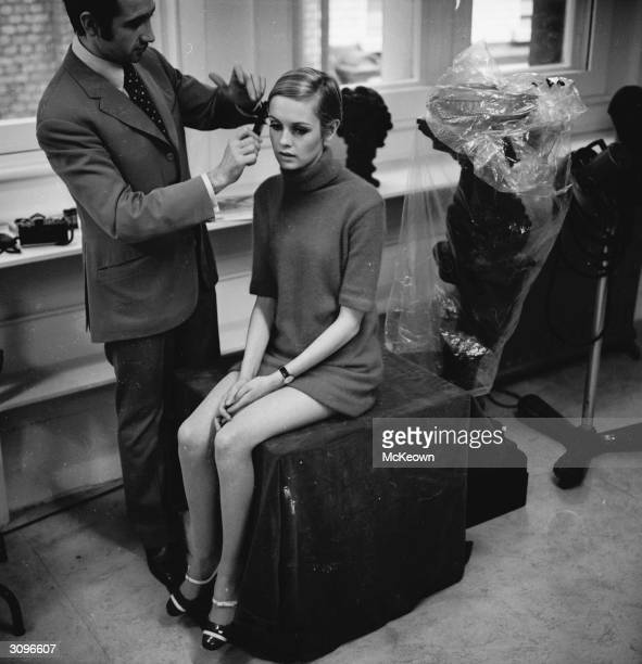 British fashion model and 60s icon Twiggy submits to the comb of her hairdresser friend Leonard.