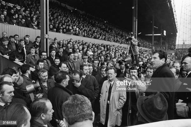 Shop Steward Mr Freddie Gore addressing a mass meeting of airport workers at Brentford Football groundThey have gathered to discuss possible strike...