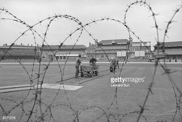 The Oval cricket ground is ringed with barbed wire in an attempt to prevent vandalism by anti-apartheid demonstrators during the South African team's...