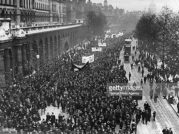 Overhead view of the large hoppickers demonstration as they walk along the Embankment in London