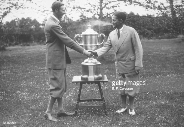 Roger Wethered congratulates American golfer Bobby Jones a member of the Walker Cup winning team at Sandwich