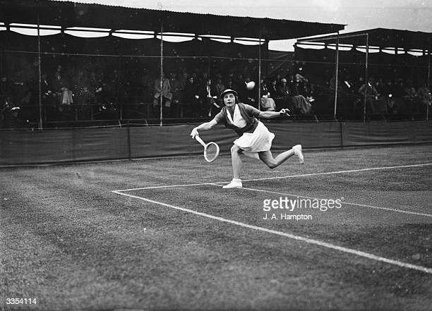 American tennis star Helen Wills in action against Mrs J B Pittman during a match at the Surrey Grass Court Championships at Berrylands Surbiton